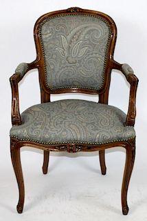 Louis XV armchair in walnut