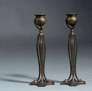 Pair of Tiffany Studios bronze candlesticks with paw feet