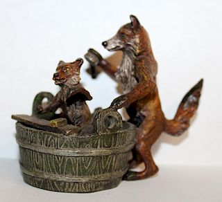 Cold painted bronze foxes