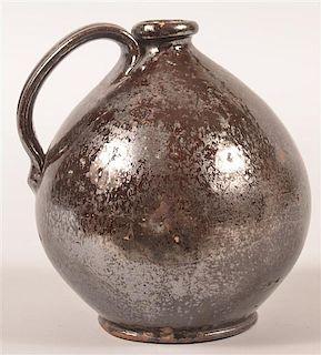 PA 19th Century Redware Manganese Glazed Jug.