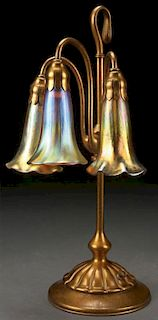 A TIFFANY STUDIOS ETCHED DORE BRONZE LILY LAMP