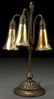 A TIFFANY STUDIOS ETCHED BRONZE LILY LAMP