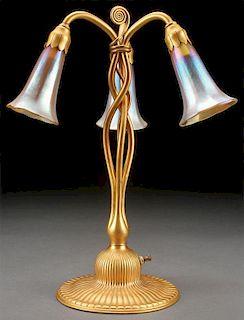 A FINE TIFFANY STUDIOS GILT BRONZE LILY LAMP