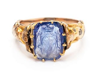 * A Victorian Yellow Gold and Sapphire Intaglio Ring, 3.40 dwts.