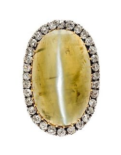 * A Silver Topped Gold, Cat's Eye Quartz and Diamond Brooch, Circa 1890, 6.40 dwts.