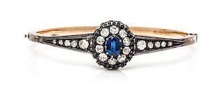A Silver Topped Gold, Sapphire and Diamond Bangle Bracelet, 8.60 dwts.