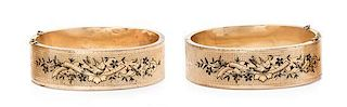 A Pair of Victorian Yellow Gold and Enamel Bangle Bracelets, 43.35 dwts.