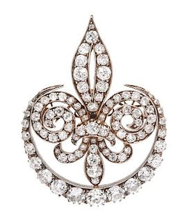 * A Victorian Silver Topped Gold and Diamond Fleur De Lys Brooch, 14.70 dwts.