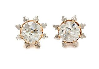 A Pair of Bicolor Gold and Diamond Stud Earrings, 2.90 dwts.