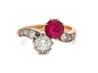 An Edwardian Platinum Topped Gold, Ruby and Diamond Toi et Moi Ring, 4.40 dwts.