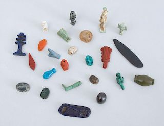 GROUP OF EGYPTIAN STONE AND FAIENCE AMULETS AND SCARABS