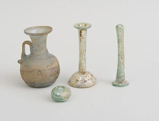 GROUP OF FOUR ANCIENT GLASS VESSELS