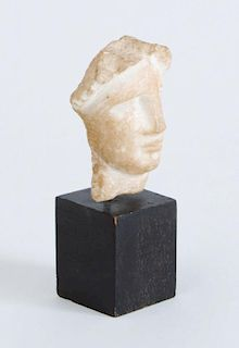 GREEK CARVED MARBLE HEAD OF A WOMAN, HELLENISTIC