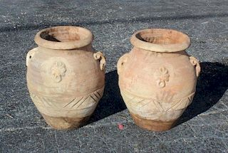 Pair of terra cotta olive oil jug style planters.