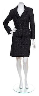 A Chanel Black Cotton Boucle Belted Skirt Suit, Skirt Size 42, Jacket and Belt Size 40.