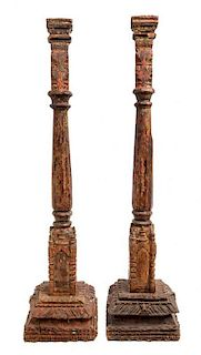 * A Near Pair of Indian Painted Wood Prickets Height 34 3/4 inches.