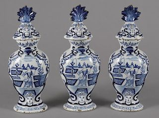 Three Delft garniture vases and covers, 18th/19th c., 13 1/2'' h. Provenance: Rentschler collection