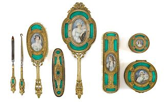 French brass and champlevé dresser set, early 20th c., with inset portraits, eight pieces.