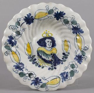 Delft polychrome charger, 18th c., the lobed body with a central royal portrait, probably King Wil