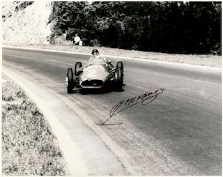 Juan Manuel Fangio in his Maserati 250 F autographed black & white photo