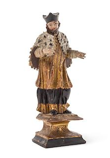 * An Austrian Painted and Parcel Gilt Carved Wood Figure Height 9 inches.