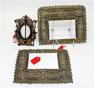 * A Pair of Spanish Baroque Style Pressed Brass Frames Each 7 x 8 7/8 inches.