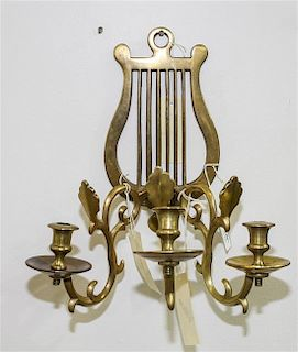 * A Neoclassical Style Brass Three-Light Sconce Height of sconce 13 1/4 inches.