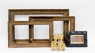 * A Baroque Style Carved Wood Frame Largest frame 24 5/8 x 14 5/8 inches.