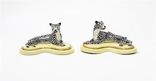 * A Pair of Porcelain Models of Recumbent Cheetahs Width 7 3/4 inches.