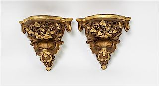 * A Pair of Giltwood Brackets Height 10 inches.