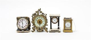 * A Group of Four Miniature Clocks Height of tallest 4 1/4 inches.