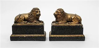* A Pair of Italian Faux Giltwood and Marble Bookends Width 7 inches.