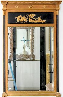 * An Empire Style Ebonized and Parcel Gilt Mirror Height 52 x width 32 inches.