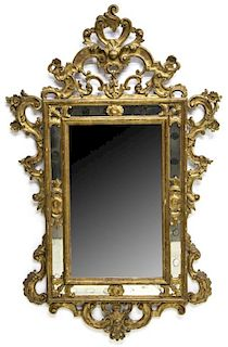 ITALIAN ROCAILLE CARVED GILTWOOD MIRROR, 19TH C.
