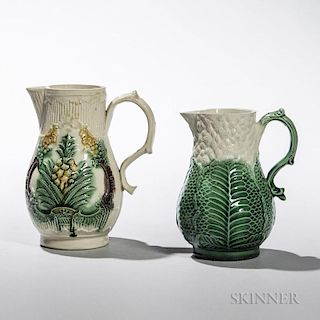 Two Staffordshire Cream-colored Earthenware Cream Jugs
