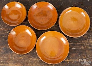 Five Pennsylvania redware plates, late 19th c., attributed to Hampton potter, Solomon Miller, larges