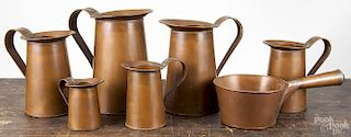 Set of six copper measures, 20th c., stamped with a buck, tallest - 10 1/4'' h, together with a coppe