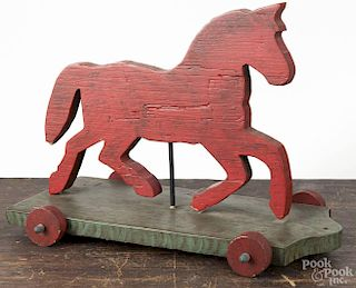 Contemporary painted pine cutout horse pull toy, 13'' h., 17 1/4'' l.