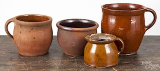 Four pieces of Pennsylvania redware, 19th c., largest 7 1/4''.
