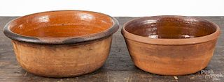 Two Pennsylvania redware bowls, 19th c., 3 3/4'' h., 9 1/2'' dia. and 3 1/2'' h., 8 1/4'' dia.