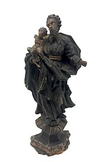 A Renaissance Carved Wooden Figurine of a Man with a Child