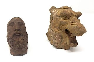 A Pair of Terracotta Figurines. A Lion Head and a Man Face