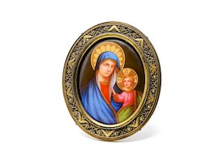 A 20th Century Porcelain Plaque of Madonna in Brass Frame