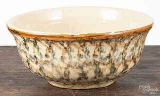 Brown and green spongeware mixing bowl, early 20th c., 5 1/2'' h., 12 1/2'' dia.