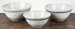 Three blue and white stoneware mixing bowls, 19th c., 5 3/4'' h., 11 1/4'' dia., 6 1/4'' h., 12 3/4'' di