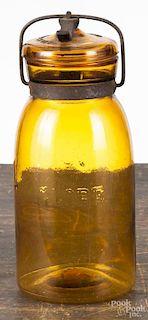 Globe amber canning jar, patented May 23, 1886, 8 3/4'' h.