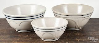 Three blue and white stoneware mixing bowls, 19th c., 5 3/2'' h., 12'' dia., 5 3/4'' x 12''and 4 1/4'' h.