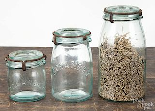 Three Cohansey fruit jars, including half pint, 7'' h., 5 1/2'' h., and 3 1/2'' h.