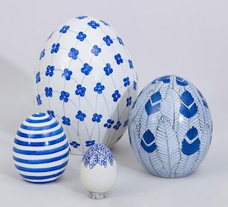 FOUR CONTEMPORARY BLUE AND WHITE GLAZED POTTERY EGGS