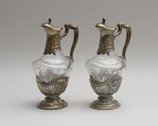 PAIR OF CONTINENTAL CUT-GLASS CLARET JUGS WITH SILVER-PLATED MOUNTS